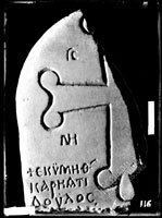 Fragment of GRAVESTONE with cross and inscription