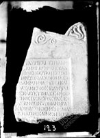 GRAVESTONE: right upper corner and part of pediment