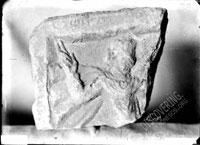 Fragment of gravestone depicting horseman with highly raised hand and inscription on top frame