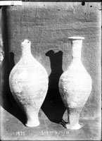 AMPHORISKOI (two), of black slip, with applied and scratched ornamentation