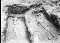 Two graves with skeletons in the necropolis at the west defensive wall