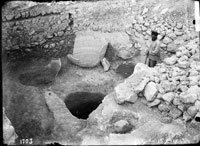 Pithoi in situ and cistern carved into bedrock