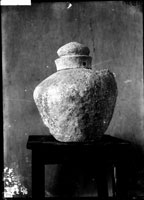 Lead urn with inscribed shoulders