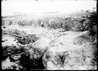 General view of the precipice in the seacoast: the edge of the excavation tench with numerous walls projectiong outside