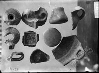Fragments of VESSELS: red-slip plate bottom, black-slip vessel bottom with graffiti, fragment of clay cooking pan, fragments of handmade vessels from the 3rd layer in the roman house (termae?), room no. 1